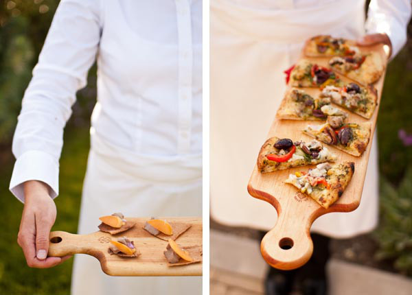 server-holding-wood-board-appetizers